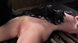 Skinny blonde tormented in device bondage
