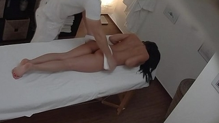 Brunette Sexy Babe in arms Secretly Fucks on Massage Table