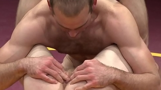 Athletic hunk enjoys in wrestling