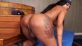 Bigass shemale babe tugging swollen cock