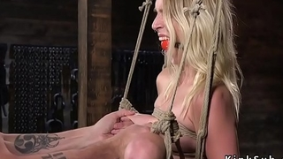 Hogtied slim blonde made to squirt