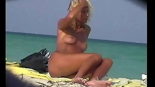 A nude beach voyeur video endowments some hot pussies, asses and cocks