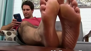 He loves cock teasing with his feet while unaffected by his drone